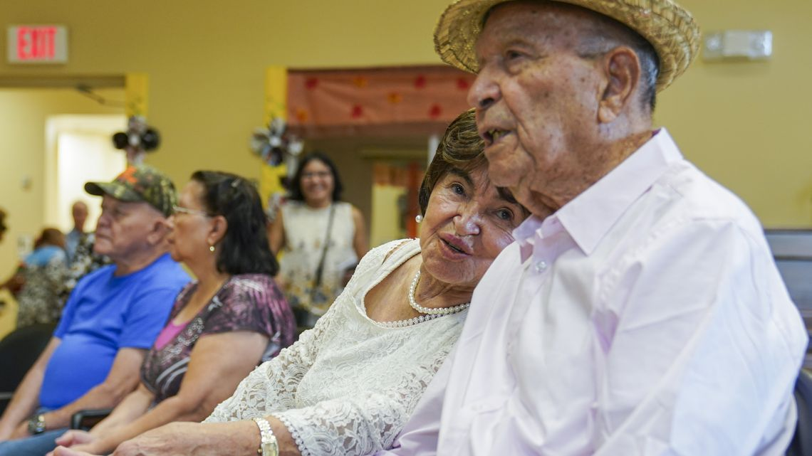 Jorge Zambrana and Fabiola Montealegre listen to the music at the Town 'N Country Senior Center